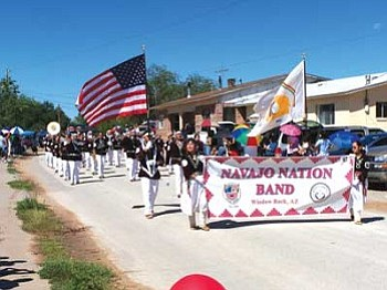 The Navajo Nation Band marches by parade spectators during the 2007 Zuni Tribal Fair parade in Zuni, N.M. (Photo by Wells Mahkee Jr./NHO).