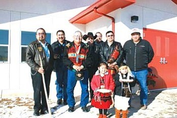 Pinedale Chapter celebrated the dedication of their new Head Start building with a school dedication on Wednesday, Jan. 16. Pictured with two Head Start students is Anselm Morgan, Pinedale Chapter Vice President; Navajo Nation Council Speaker Lawrence T. Morgan; Raphael Martin, Pinedale Chapter President; Young Jeff Tom; Charles Long, Legislative Staff Assistant; Bobby Sandoval; and Olsen Arviso, Jr., owner of Arviso Construction (Photo by Joshua Lavar Butler/NN-OS).