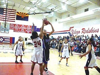 Valley's Marcy Nelson (5) scores over Red Mesa's Legenia Wagner (24) in the lane (Photo by Anton Wero/NHO).