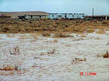 A virtual ocean of floodwater stands just yards from a home site at an unidentified location in the Bird Springs Chapter. Many chapters in northern Arizona — including those in Navajo County — have been hit hard by recent heavy snowstorms and the resulting snow melt caused by warmer temperatures (Photo by Lt. Emerson Lee, NPD).