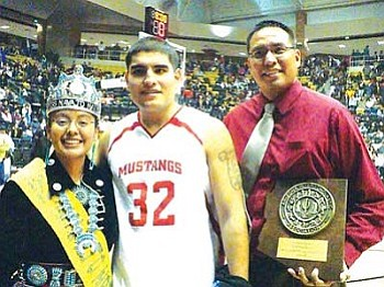 "Miss Navajo Nation Jonathea D. Tso (left) with Arizona 3A North Region Boys 'Most Valuable Player"" Reggie Todachine and ""Coach of the Year"" Jacob Holiday, both of the Monument Valley Mustangs (Photo by Anton Wero/NHO)."