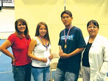 TNANAF's 2006 Scholarship winners Sherilyn Thomas and Tyrrell Tahe stand with TNANAF board member Constance Benally and Flagstaff High School Native American advisor Josie Begay-James (Courtesy photo).