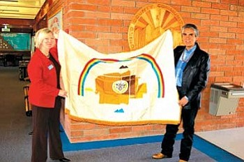 Navajo Nation President Joe Shirley, Jr., presented a Navajo Nation flag to Coconino Community College President Leah L. Bornstein at Saturday's Presidents' Summit in Page (Photo by Frank Talbott).