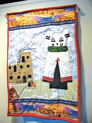 Somana Yaiva's Snow Maiden quilt remains on display at the Smoki Museum. Yaiva's quilt was chosen to represent the show and is featured on banners and programs (Photo by S.J. Wilson/NHO).