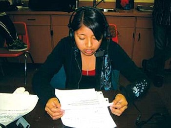 Joelle Mansfield goes on the air as the new environmental editor for the Hopi High Teen Show, the only live remote Native American teen talk show in the nation. Mansfield said she has a passion for the environment because nature is pretty and pollution is ugly (Photo by Stan Bindell/NHO).