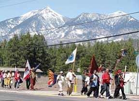Longest Walk 2 participants walk toward Flagstaff along Route 180. Upon reaching Flagstaff they had walked 980 miles in 39 days.