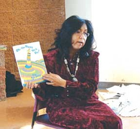 Navajo First Lady Vikki Shirley reads to students at the Navajo Nation Museum and Library on March 17.