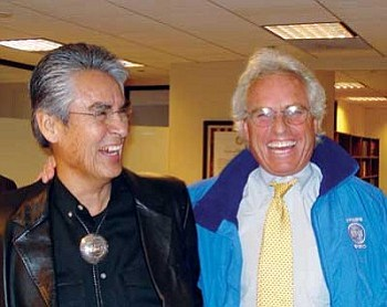 Navajo Nation President Joe Shirley Jr. and Citizens Energy Chairman and President Joseph P. Kennedy smile for the camera after signing an agreement that will promote the development of wind energy projects on Navajo lands (Photo by Deswood Tome/NNWO).