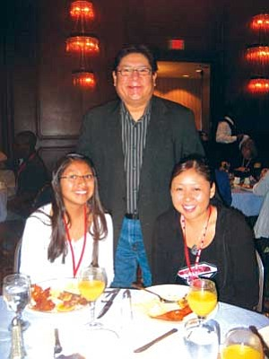 Hopi High radio students Johnetta Honie and Joelle Mansfield with Burt Poley, director of Native Voice 1. Poley previously worked at KUYI.