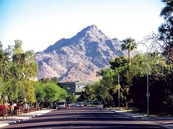 "Piestewa Peak, formerly known as Squaw Peak, was officially renamed April 10 by the U.S. Board on Geographic Names to honor the memory of Lori Piestewa and other fallen soldiers. Because the term ""squaw"" is considered offensive by many Native American tribes, Arizona changed the name of the peak five years ago amidst much criticism. However, the decision to rename the peak is being hailed by many who believe this is a positive step towards uniting people in this country (Photo by Darin Mahkee)."