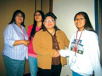 KUYI Station Manager Kathy Sahmie shakes with Jackie David and Hopi Foundation Program Manager Monica Nuvamsa welcomes Joelle Mansfield (Photo by Stan Bindell/NHO).