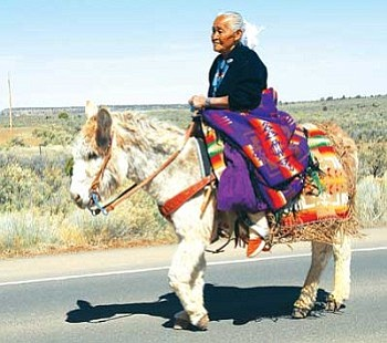 Lucy Bahe of Tsaile rides a donkey in the Diné College 40th Anniversary Parade.