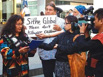 A supporter of Dooda Desert Rock speaks to members of the press regarding concerns over the proposed Desert Rock Energy Plant in northwestern New Mexico. A letter was delivered to Sithe Global informing them that a number of Navajo people are not in support of the project.