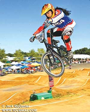 Blake Foxx, Navajo/Hopi, is caught in mid-air as he races a BMX course. Foxx, age 15, is seeking to compete in the UCI BMX World Challenge in Taiyuan, China and win the world championship. Foxx has been active in BMX racing since the age of six (Photo courtesy of Lori Foxx).