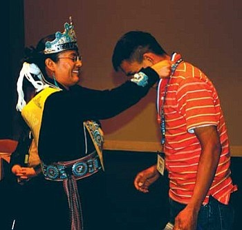 Tuba City High School construction student Clint Butler receives his contest medal from Miss Navajo Jonathea Tso at the SkillsNATIVE held in April at Pinon High School (Courtesy photo).