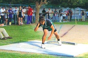 Tuba City High sophomore Trisha Curley placed fifth in the women's shot put (Photo by Carl Perry).