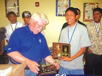 Baseball Coach Ben Willey and Lane Benally enjoy a laugh after Benally received his award (Photo by Stan Bindell).