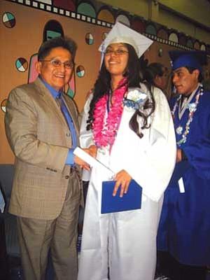 Hopi Tribal Chairman Ben Nuvamsa poses with Hopi High radio student Jackie David (Photo by Stan Bindell/NHO).