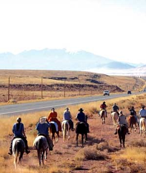 On the weekend before Thanksgiving 2006, horseback riders from across the Navajo Nation came together to bring attention to the ongoing struggle to protect the sacred San Francisco Peaks (Photo by Klee Benally).