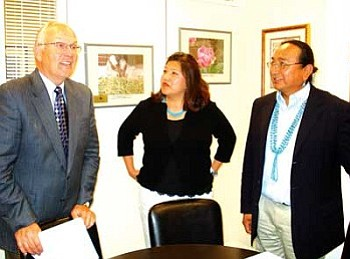 Senator Larry Craig (R-Idaho, left) speaks with Navajo Nation Council representatives Hope McDonald-Lone Tree (center) and Rex Lee Jim, who serves as Chairman of the Public Safety Committee.