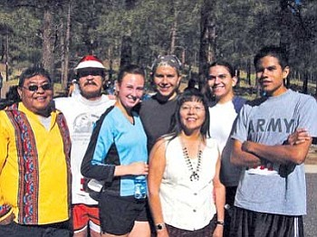 <i>Photo by S.J. Wilson/NHO</i> <br> A family affair — Gerald Lomatewaima (at far left) joins the Darden family after the 25th running of NACA's Sacred Mountain Prayer Run. He is with (from left to right) Steve Darden, Krista Monaghan, Kyle Darden, Rose Tohe, Kobe Darden and Seth Darden.
