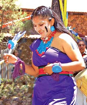 <i>Photo by Michele Mountain/MNA</i><br>A female dancer from the Nuvatukya' ovi Sinom Dance Group performs.