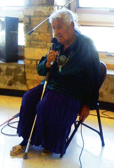 <i>Courtesy photo</i><br> Navajo elder Catherine Smith from Big Mountain speaks at a Black Mesa town hall meeting held June 7.