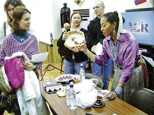 <i>Courtesy photo</i><br> Radmilla Cody shares some insights about Navajo culture with an interested visitor during her recent visit to Moscow, Russia.
