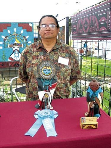 Gerry Quotskuyva with his award winning katsina carving.