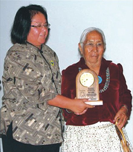 <i>Photo by Bronson Peshlakai</i><br> Delia Carlyle (left), a member of the Inter Tribal Council of Arizona, presents the Frank Harrison and Harry Austin Citizenship Award to Agnes Laughter at a banquet held July 15.