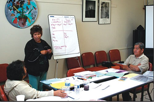 <i>Photo by Ethan Elkind Nakwatsvewat</i><br> -Trained mediator Doris J. Redford (standing) leads a practice mediation session with Orlan Tewa and Lorena Banyaca.