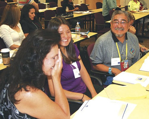 <i>Courtesy photo</i><br> Robert Nakai, Navajo Nation Special Diabetes Project (NNSDP) program manager, shares a laugh with Gloria West, project and program specialist and Nadine Butler, NMSU intern, before the start of their meeting with Arizona Diabetes Coalition in Scottsdale on July 18.
