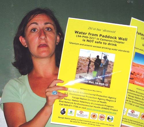 <i>Courtesy photo</i><br> An official with the U.S. EPA, Region 9 holds up signs informing people of water wells across the Navajo Nation that are contaminated with unsafe levels of uranium. EPA officials met with representatives from Black Falls and Tuba City on Aug. 10 and 11.