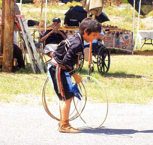 A young hoop dancer performs at last year's Peshlakai hoop dance contest in Tusayan. This year's contest will be held Labor Day weekend. Many categories are available and prizes will be awarded to the winners in each category. For additional information, visit www.peshlakai.org