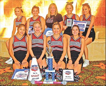 Bottom row from left to right: Shyla Burgess, Robbin Collins, Hailey Weaver, and Symone Ross. Top row from left to right: Marisa Hambleton, Shelby Blossom, Coach Bonnie Griffin, Sherniec Scraper, and Nicole Laconsello.