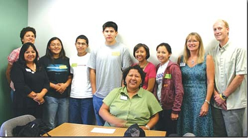 Recipients and participants of Native American research awards: from left, Jani Ingram, Catherine Talakte, Danielle Charley, Michael Flanagan, Lias Hastings, Kayleen Wilson, Charmayne Sandoval, Maribeth Watwood and Brandon Cruickshank. Seated is Jenny Y. Buckinghorse, a senior administrative specialist in the Native American Student Services center. Not pictured is Cristal Gomez.