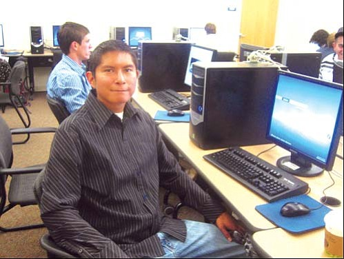 <i>Erik Bennett sits in a computer lab at New Mexico Tech in Socorro.</i>