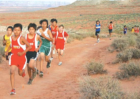 <i>Courtesy photo</i><br> A member of the Tuba City Boarding School boys cross country team leads a pack of runners to the finish line.