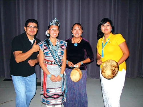 Comedian Pax Harvey of Lukachukai stands with 2008-2009 Miss Greyhills Wiltrina Riggs and his sister Roxanne Harvey and singer Andrea Charlie.