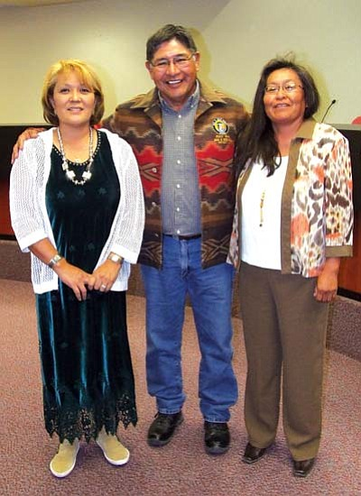 <i>Courtesy photo</i><br> Retiring Navajo County Supervisor Percy Deal (center) was given a woven jacket as a gift from Constable Esther Grass (left) and Justice of the Peace Suzie Nelson in appreciation for his 28 years with Navajo County on Oct. 20 in Kayenta.