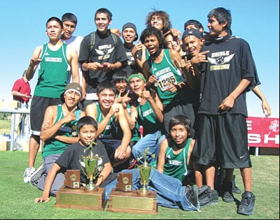 The 2008 3A State Champion Tuba City Warriors and runner-up Chinle Wildcats pose with their team trophies.
