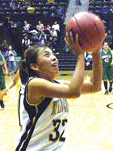 <i>Photo by Anton Wero/NHO</i><br> Chinle Lady Wildcat's Samantha Pahe (32) drives the lane for two points in their win over the Wingate Lady Bears, 58-47.