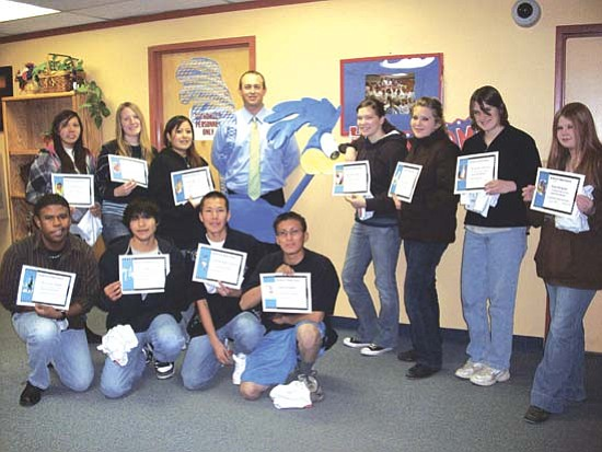 "November students: Above standing (pictured left to right): Alisha Keyonnie (Reading), Emily Peterson (Fine Arts), Nicole Woodty (Navajo Language),  Robbie Koerperich (Assistant Superintendent), Ronnie ""the Roadrunner,"" Katrin Bottke (Drama), Jennifer Turley (Social Studies), Kasandra McLaws (Job Skills), and Siera Despain (Science). Kneeling (pictured left to right): Decoven Adams (Career Technical Education), Bryson Keoni (Math), Christopher Chester (English), and Heber Samm (Health). Not in pictured: Erin Yellowhair (NAVIT)."