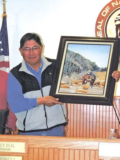 <i>Courtesy photo</i><br>Outgoing Navajo County Supervisor Percy Deal holds a painting by Cynthia Fernell Parsons, one of many gifts from the Board of Supervisors, County elected officials and employees, who honored Supervisor Deal at their Board meeting Dec. 16.