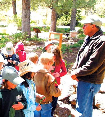 <i>Courtesy photo</i><br>Docent Bob Brown leads a children's group on a tour of the gardens at the Flagstaff Arboretum.