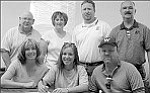 Photo by Jeff Pope Tessa Ramsey (center) signs her letter of intent to play softball with Southern Virginia University next year surrounded by her parents, Tammie and Kevin Ramsey (sitting) and Athletic Director Don Petranovich, Coach Becky Barris, Asst. Coach Chris Gilmore and Principal Doug Watson.