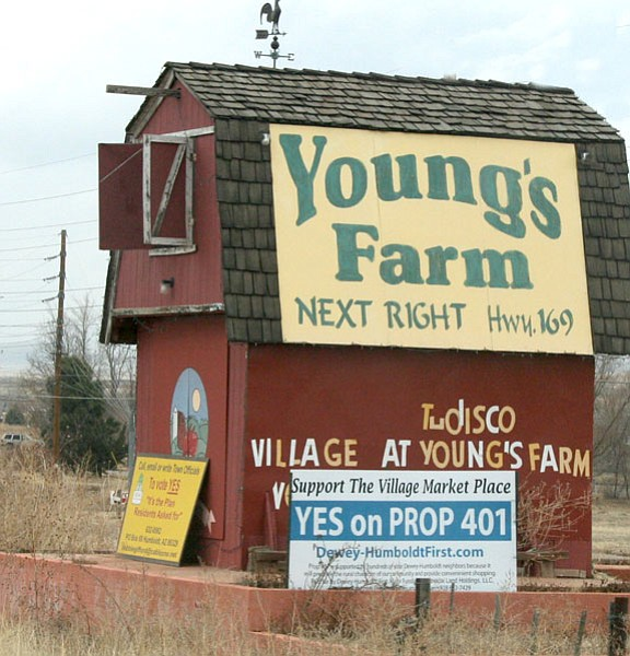 Trib Photo/Sue Tone<br> The sign encouraging voters to vote yes on one of two D-H referendums hopes to set straight an incorrect recommendation on the ballot urging a no vote by Don Allison, developer of the former Young's Farm property.