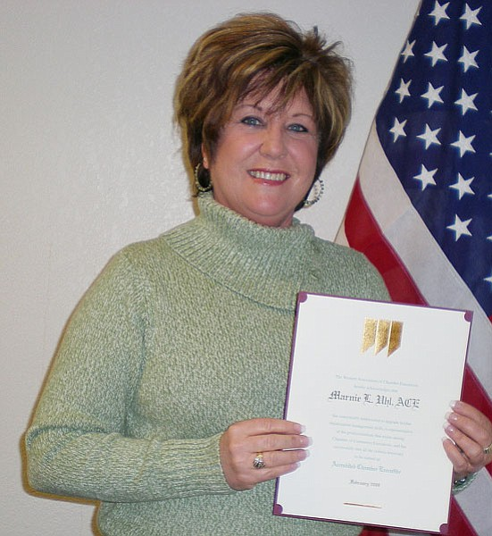 Courtesy Photo<br> Marnie Uhl, Prescott Valley Chamber of Commerce CEO and president, shows the certificate she received for  her designation as an Accredited Chamber Executive.