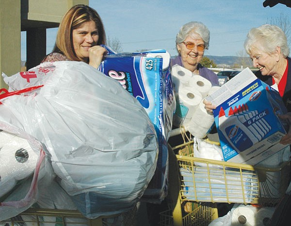 Trib Photo/Cheryl Hartz<br> At Step One this past Wednesday the Yavapai Chapter of the Daughters of the American Revolution unload household goods and personal items that DAR members collected for the women and children's shelter. From left are: Mayra Enriquez from Step One, and DAR members Phyllis Kepner and Dorothy Castanos.