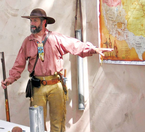 Courtesy Photo<br> During an historical presentation, Todd Weber, dressed in frontier garb, indicates on a map the route of the Lewis and Clark expedition.